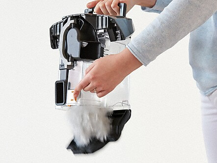 Person emptying the push2open vacuum dust container